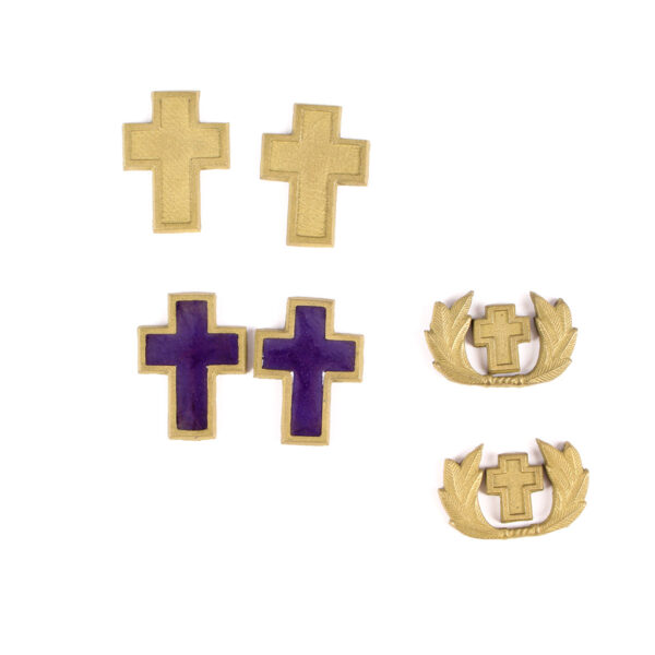 Resin shoulder and collar insignia for a priest.