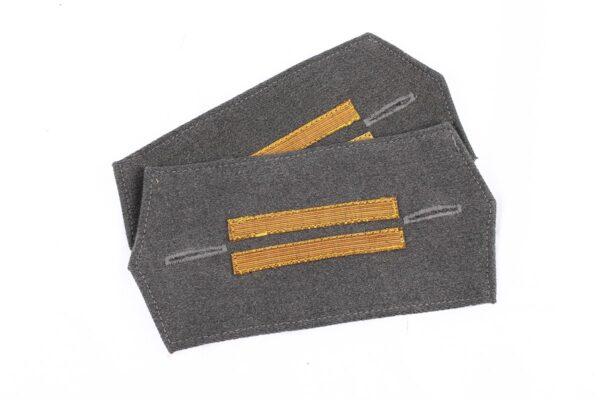 Raincoat insignia with original period rank stripes.