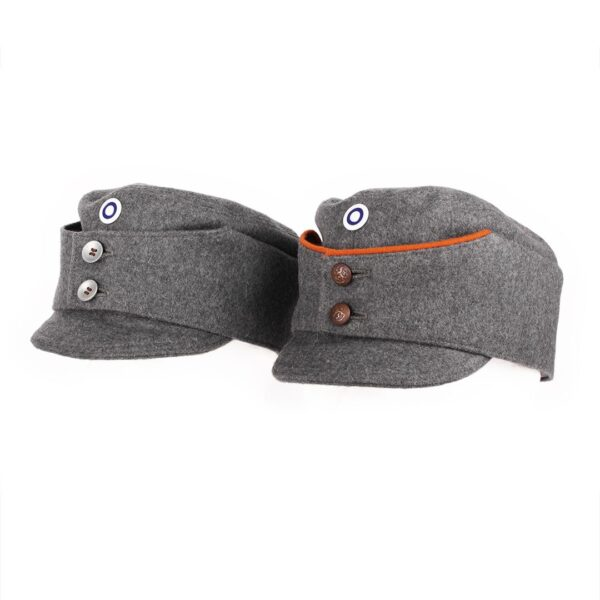A pair of slightly customized m/36 hats.